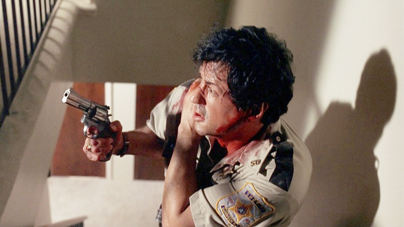 Stallone as Sheriff Freddy Heflin with his Smith & Wesson Model 686.