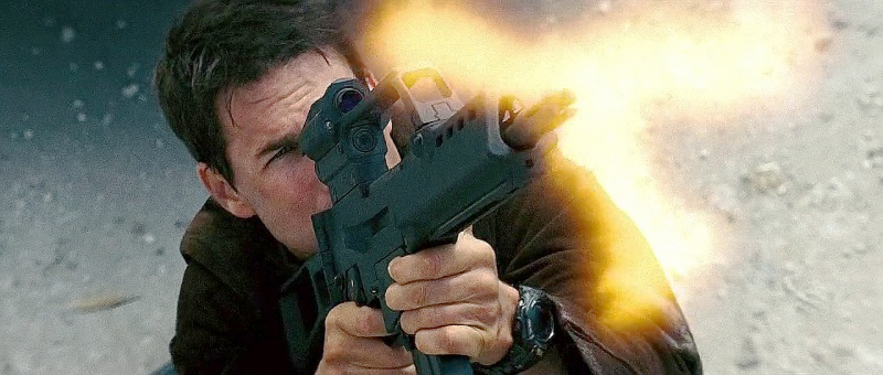 Cruise fires the G36K, gripping the magazine well as he often does in movies.