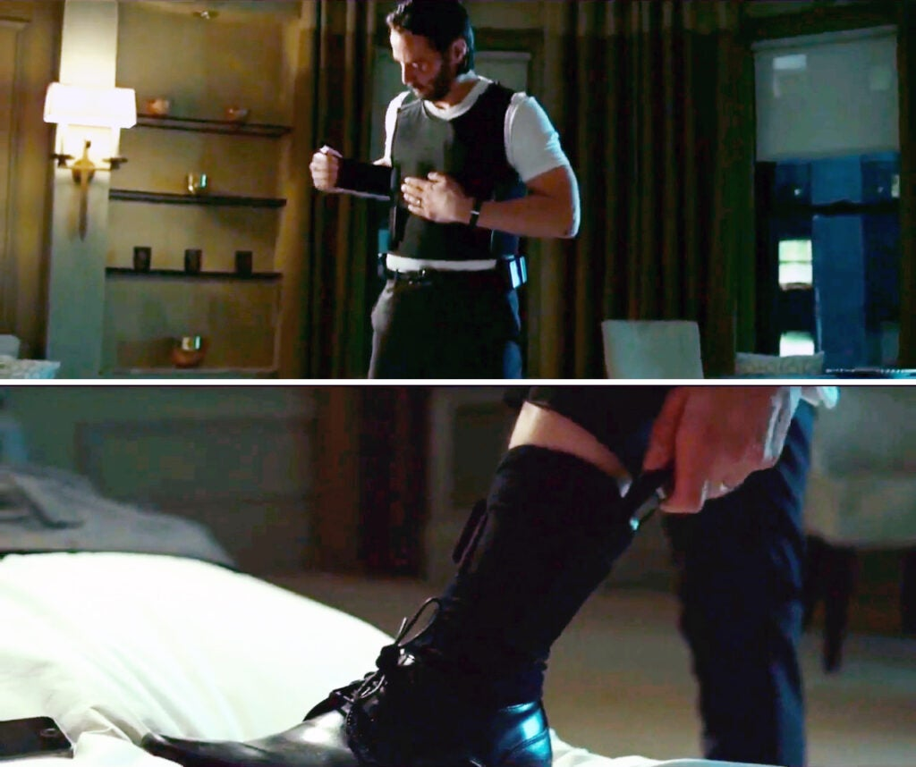 Wick adjusts his bulletproof vest and stows his Microtech Ultratech knife in a sheath on his ankle.