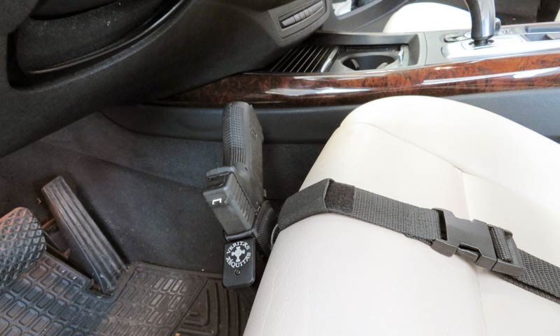 concealed carry gun holster strapped to a seat
