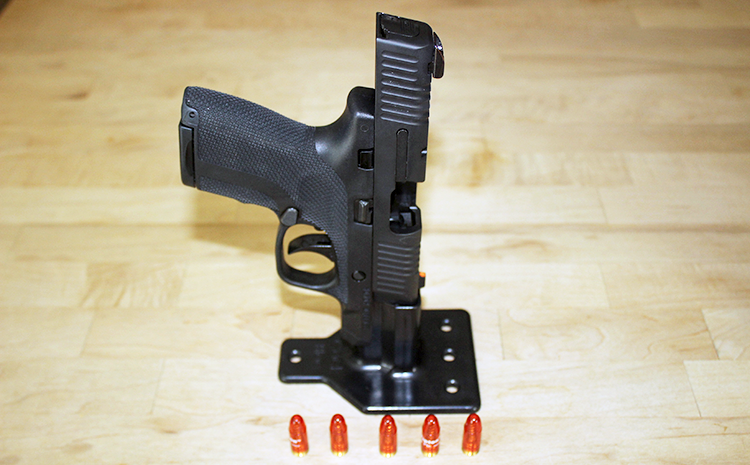 The author's Honor Guard pistol in the Bravo Bloc, with snap caps for practicing.