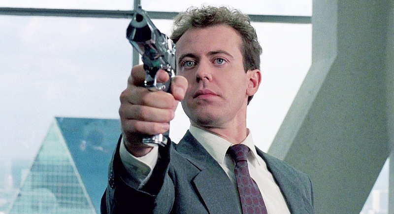 The ill-fated OCP executive Kinney (Kevin page), holding the chromed out Desert Eagle Mark I on ED-209, just like he was told.