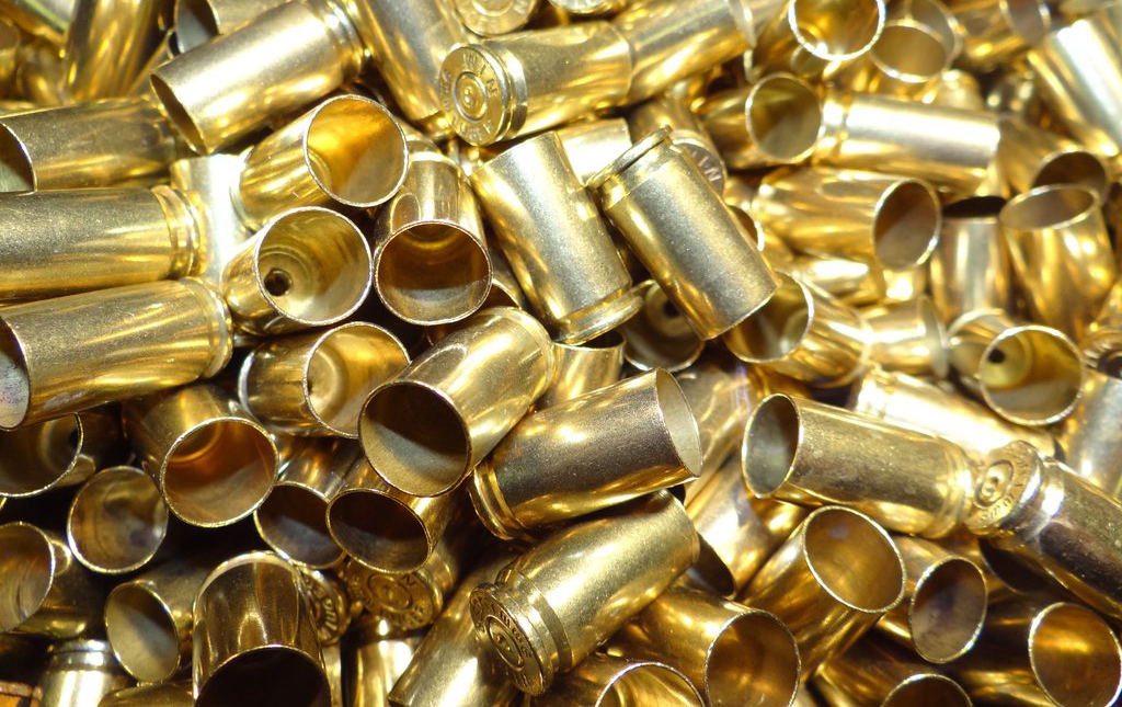 You should expect to get hit with some hot flying brass, especially at an indoor range where spent casings tend to bounce around a bit.