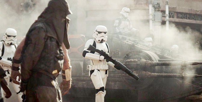 A Stormtrooper with a BlasTech T-21 blaster rifle.