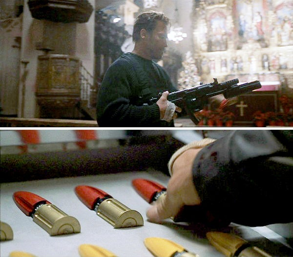 Cane grabs two different types of projectiles for the 40mm launcher while in his company's armory.