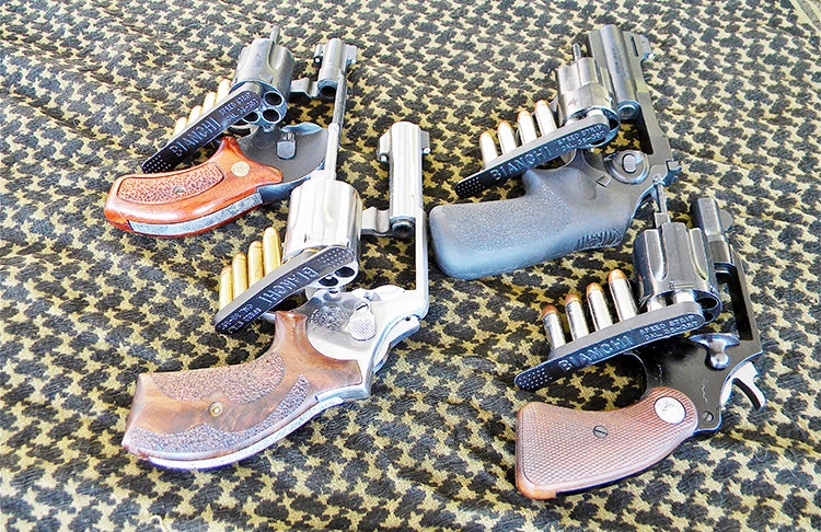 Loading a revolver with Bianci SpeedStrips: The rubber is flexible, so it peels away from the bases of the cartridge, making it easy to charge the weapon two rounds at a time.