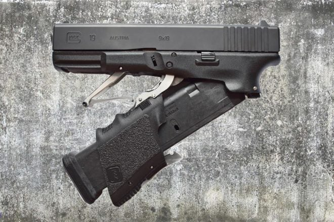 The M3 as it opens. Notice how the magazines is correctly positioned.