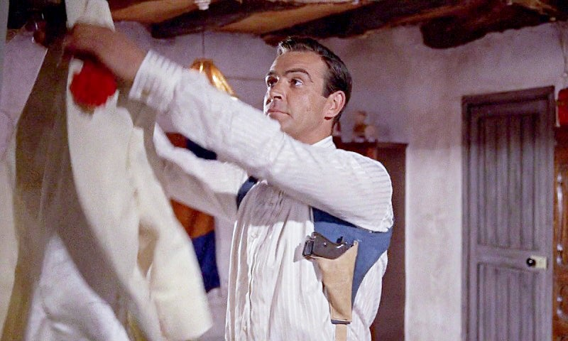 In *Goldfinger* we get a good look at Bond's PPK and the shoulder holster Bond carries it in.