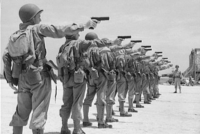 Soldiers training with M1911A1 pistols.