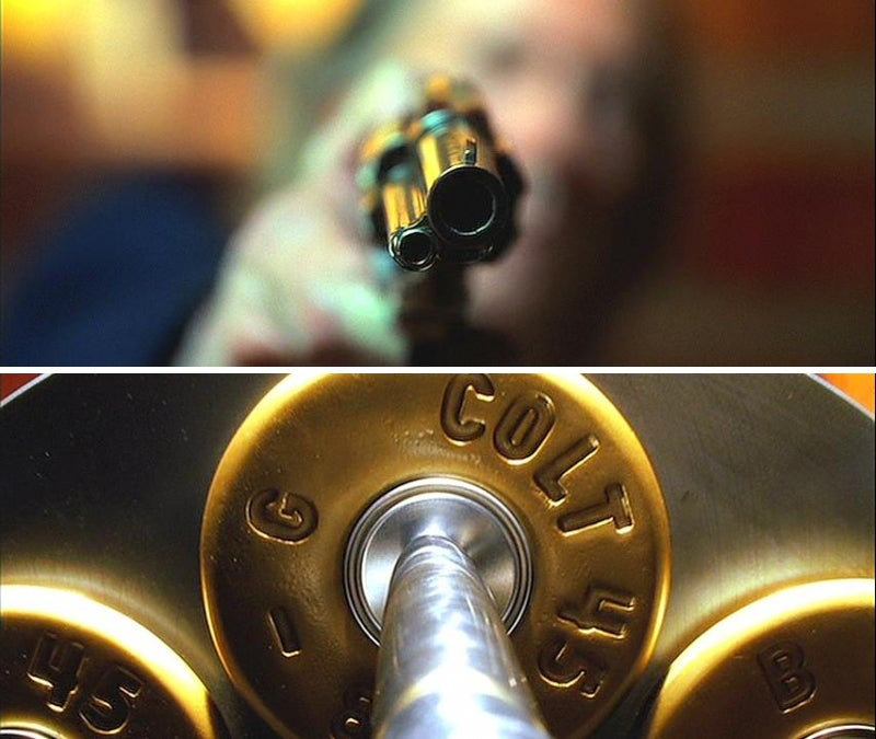 Bill fires his colt at Beatrix and we see a closeup of a firing pin striking the primer of a .45 Long Colt cartridge.