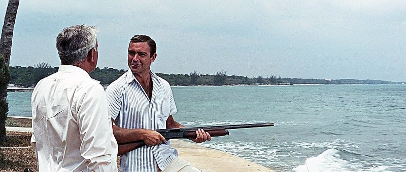 Bond shoots clays with Largo using a Browning Auto 5 shotgun.