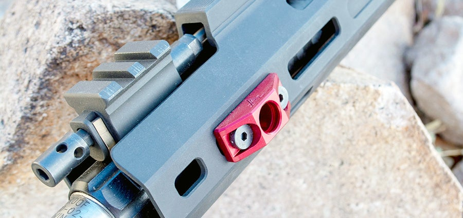 There's an ambidextrous quick-attach sling connection on the back of the receiver. This is complemented by two sling points mounted on the forward portion of the handguard.