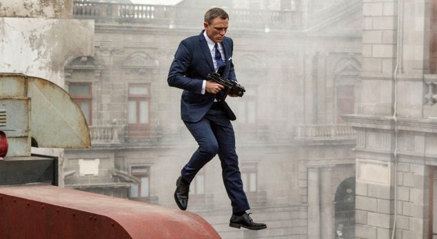 Bond traverses rooftops with his suppressed Glock 17 with a FAB Defense KPOS Glock to Carbine Conversion kit.