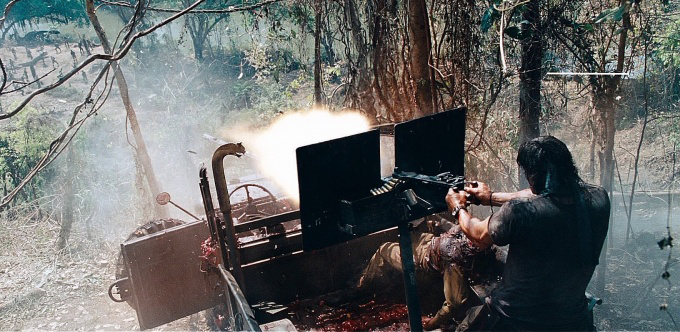 Rambo cuts down bad guys and trees with the .50-caliber machine gun.