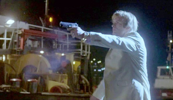 Castle uses a Colt Officer's 1911 when posing as a foreign arms dealer in the movie's prologue.