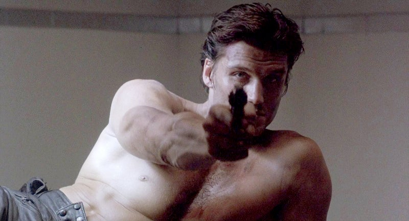 Castle aims the S&W revolver after being tortured by the Yakuza.