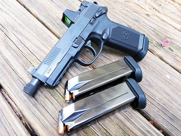 This FNX 45 Tactical comes with mounting plates to attach a variety of red dot makes.