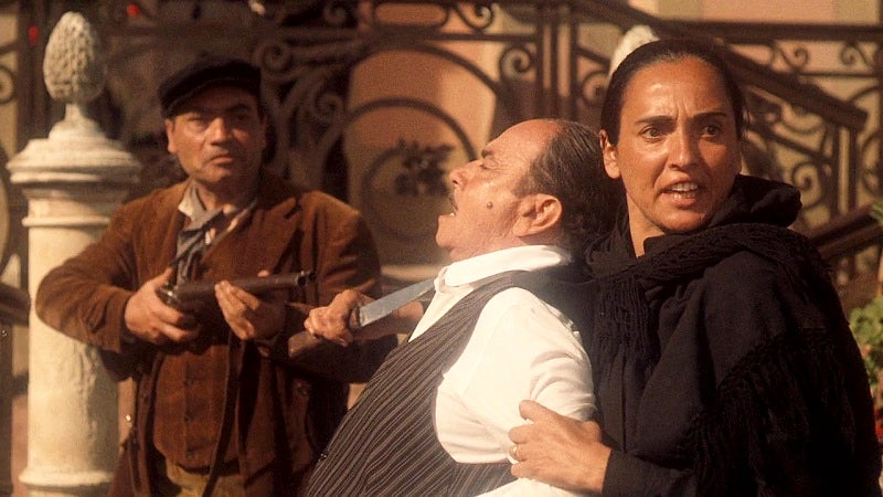 Don Ciccio's guards use double-barrel shotguns with exposed hammers to kill Vito's mother.