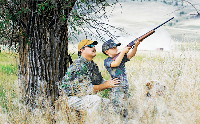 Shotgun shooters should be at least 5 feet tall and 80 pounds. This small boy is leaning back with his head off of the stock—a recipe for a miss.