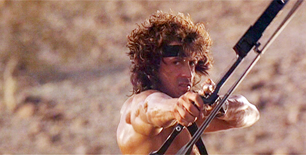 Rambo returns with the Hoyt compound bow and explosive arrows, and uses a bow-mounted quiver this time.