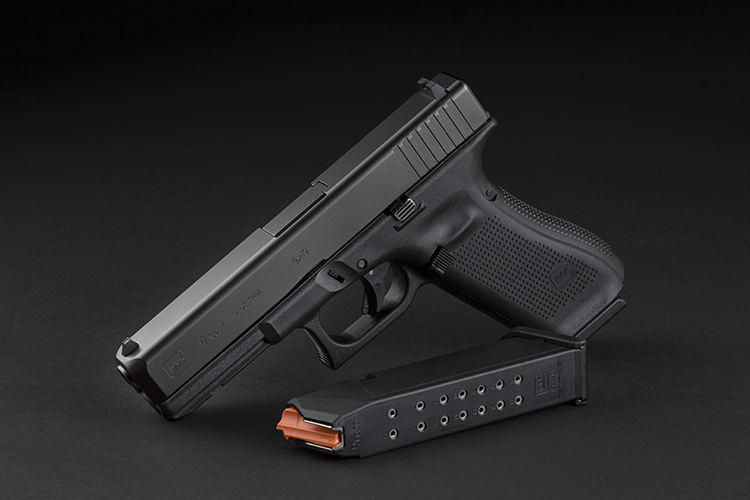 The pistols are shipping with new Glock magazines that have an orange follower and an extended floorplate.