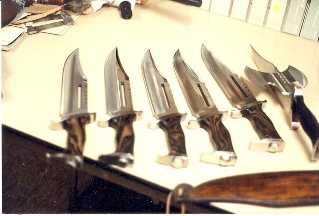 An early Gil Hibben prototype of the Rambo III knife can be seen on the right with a horizontal blade fixed in the slot cut in the main blade.