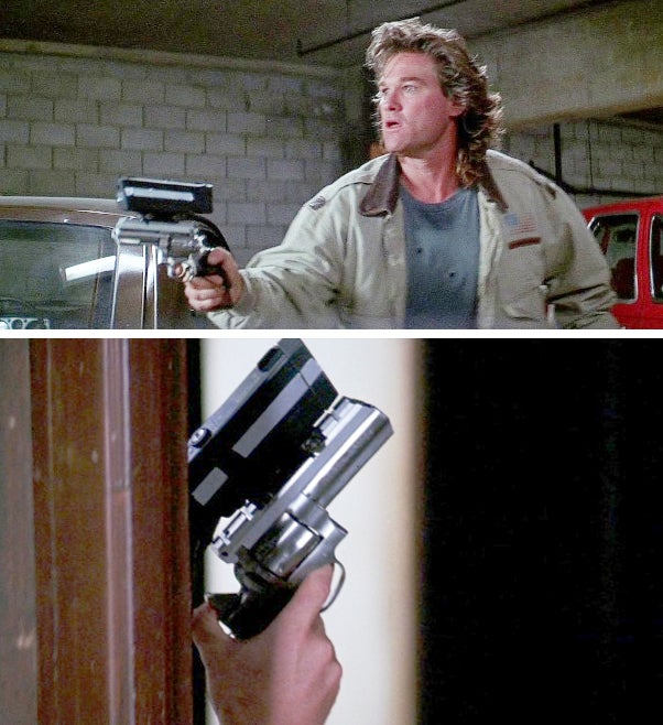 Cash carries a **Ruger GP100** with a preposterously large laser sight mounted on top.