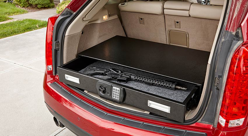 hornady truck vault gun storage in the back of a red suv