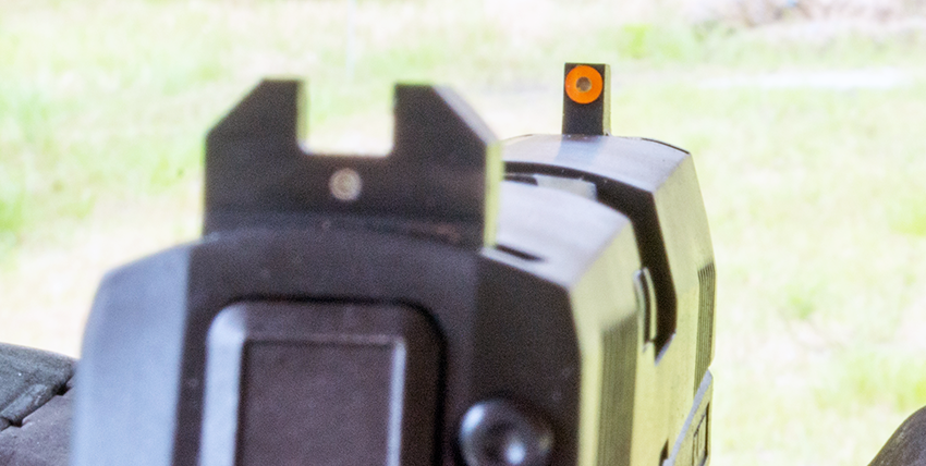 Note the center dot in the rear sight housing. It sits below the front dot for fast alignment, forming a figure eight. Note the rounded corners of the bottom of the notch in the rear sight.