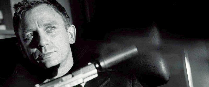 Daniel Craig's first appearance as Bond with the character's new signature pistol, the Walther P99.