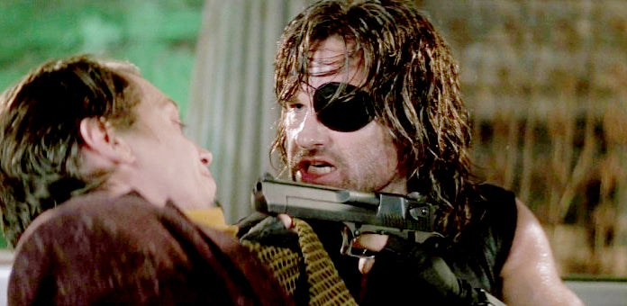Snake aims a Desert Eagle Mark VII at Map of the Stars Eddie.