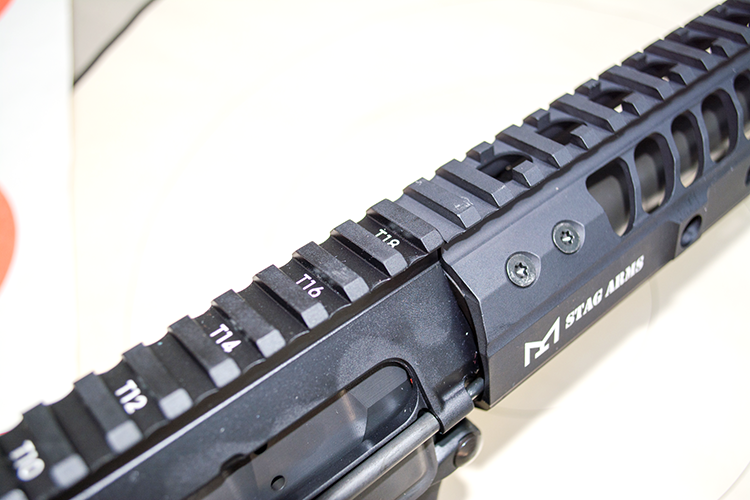The top rail seamlessly mates to the receiver rail and extends all the way forward.