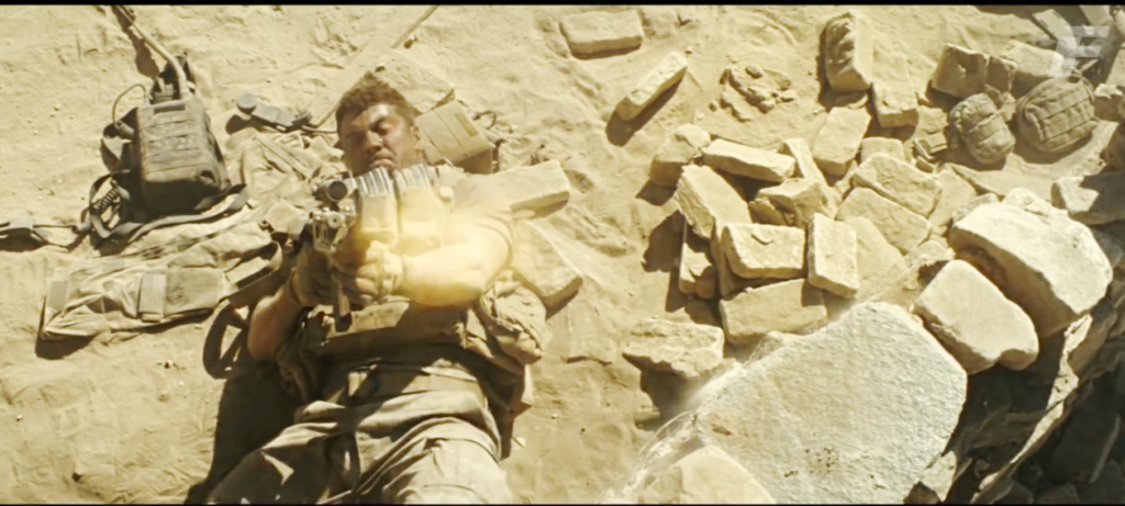Isaac fires his M4 at the top of the wall in an attempt to confuse the enemy sniper during a dust storm.