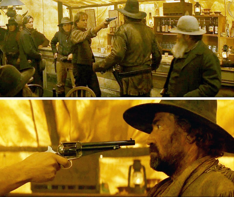 Wyatt uses his Remington Model 1875 to chase off a man with a short fuse in a canvas tent bar.