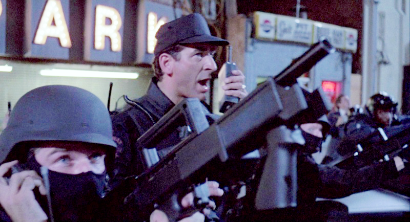 A Detroit police officers with a Mossberg 500 Bullpup shotgun.