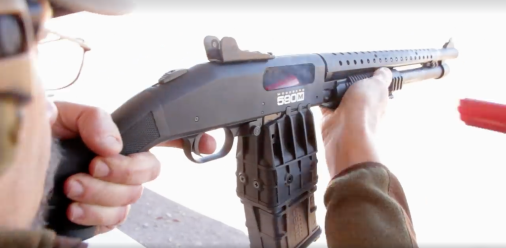 The new Mossberg 590M in action. The 12-gauge shotgun uses detachable box magazines in 5-, 10-, 15-, and 20-round capacities.
