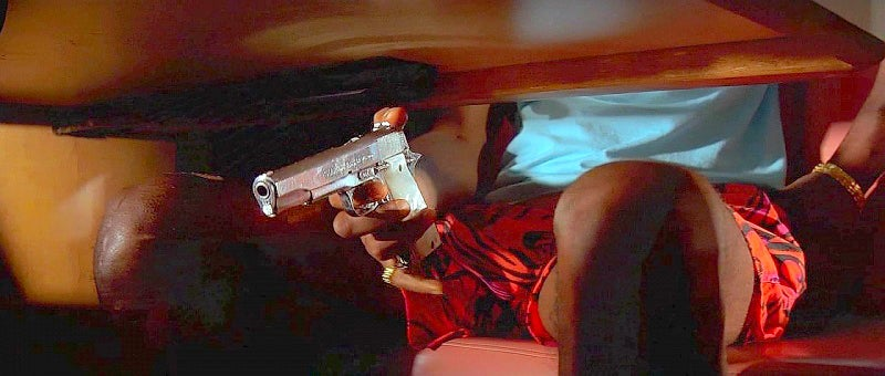 Jules cocks the hammer on his Star Model B pistol in 9mm during the diner robbery.
