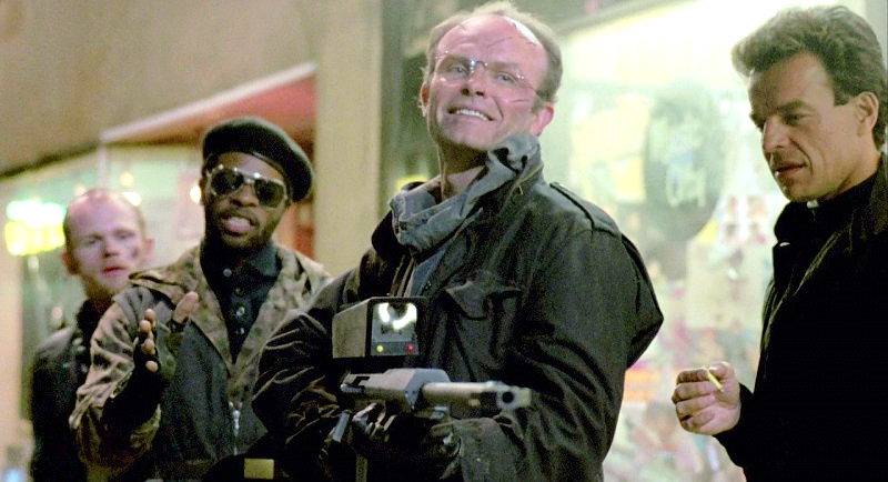 Boddicker aims at a car with his Cobra Assault Cannon.