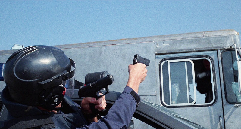 Murphy fires both his SIG Sauer P226 and Lewis' HK P9 pistol at Boddicker and his gang during the highway chase scene.