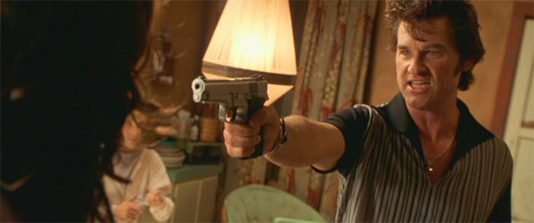 Michael with his S&W 5946 pistol in the motel.