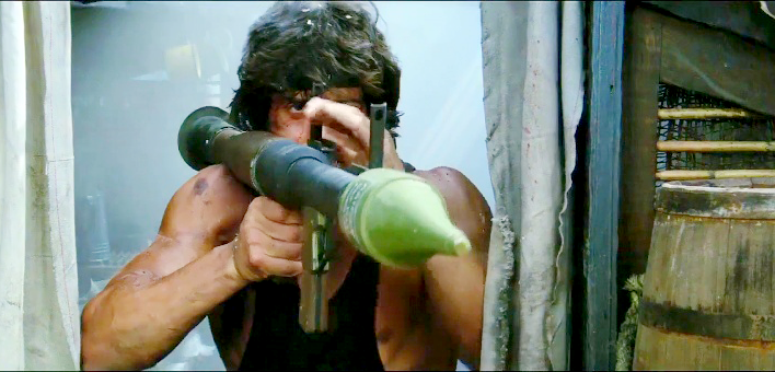 Rambo aims the mock-up RPG-7 launcher on the pirate boat.