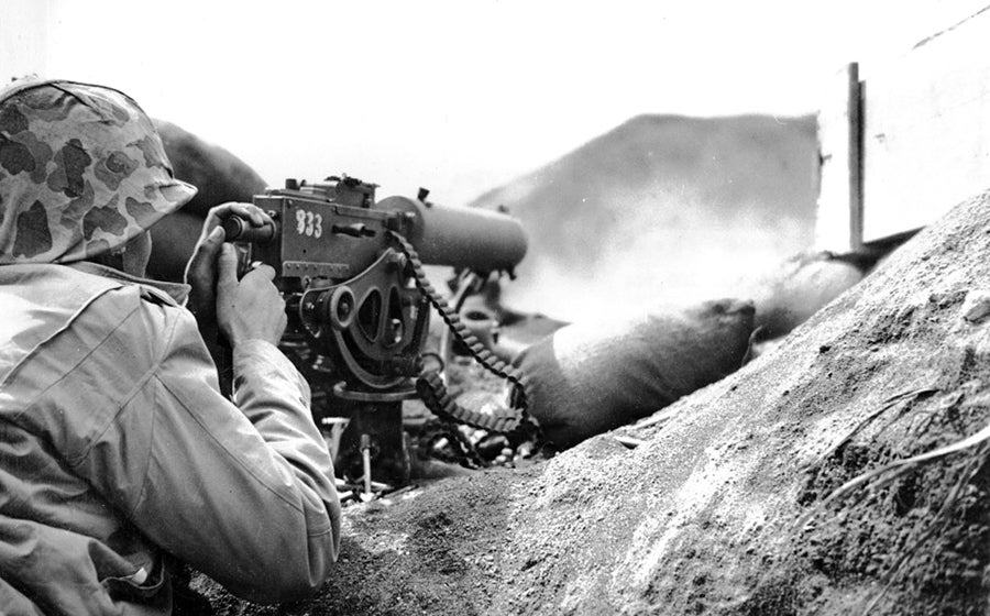 A U.S. Marine firing a Browning M1917 at the Japanese at the Battle of Iwo Jima.