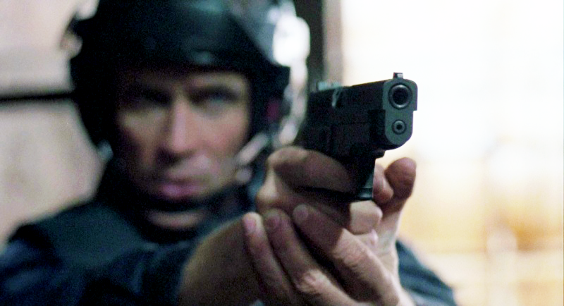 Murphy aims his SIG Sauer P226 with a 1980s-movie teacup grip during the factory confrontation before he is mangled by Boddicker and his gang.