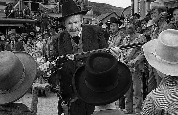 Will Geer as Earp presenting the shooters in the competition with a custom Winchester 1873 Rifle.