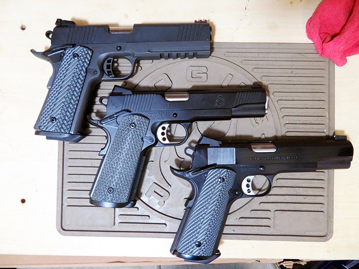 All 1911s may look similar but the field stripping technique can differ. Armscor TAC series pistols (top) and the Springfield Armory TRP (middle) are built with a recoil rod guide. The Colt Spec