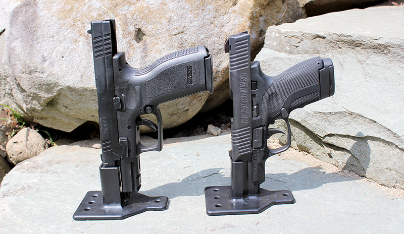 The two sizes of Cock Bloc devices holding a Springfield XD (left) and a Honor Defense Honor Guard pistol.