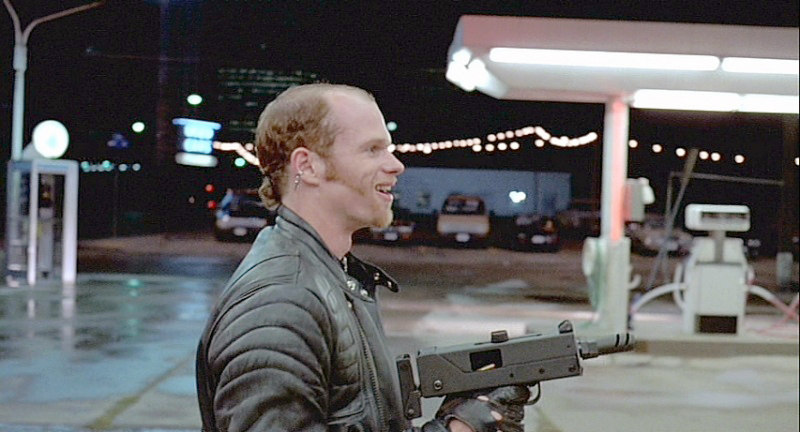 Emil with his Ingram MAC-10 during the gas station scene. The MAC-10 is fitted with a compensator and a modified folding stock. One of the same MAC-10s was used in several episodes of *Miami Vice*.