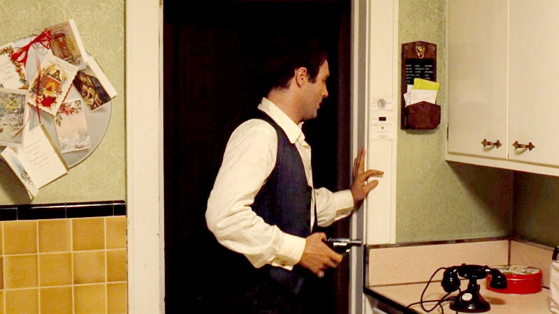 Sonny apprehensively answers the door with his S&W Model 36.