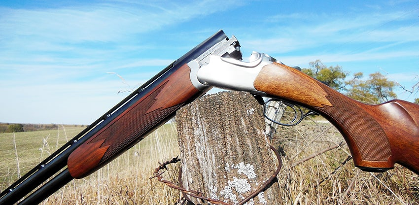 A Ruger Red Label shotgun with the action open.