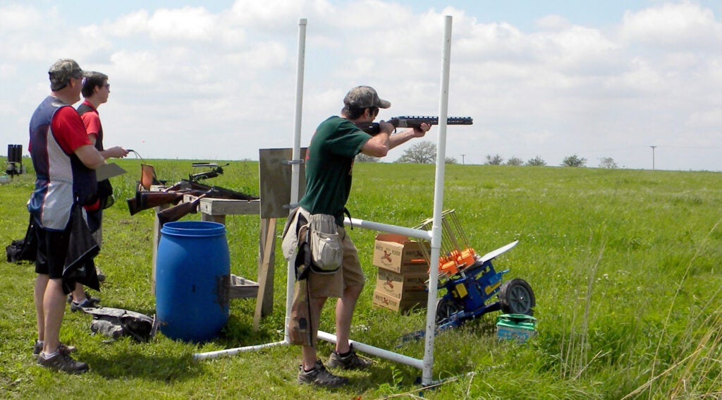 A shooter on a sporting clays course.